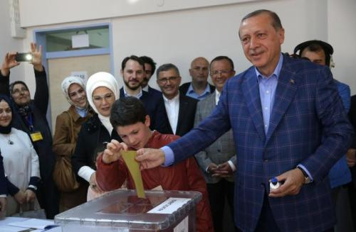 Turkish President Erdogan with his wife Emine casts his ballot at a polling station during a referendum in Istanbul